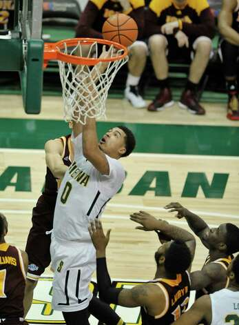 Javion Ogunyemi of Siena puts up a shot during their game against Iona at the Times Union Center on Sunday, Jan. 4, 2014, in Albany, N.Y.   (Paul Buckowski / Times Union) Photo: Paul Buckowski / 00030029A