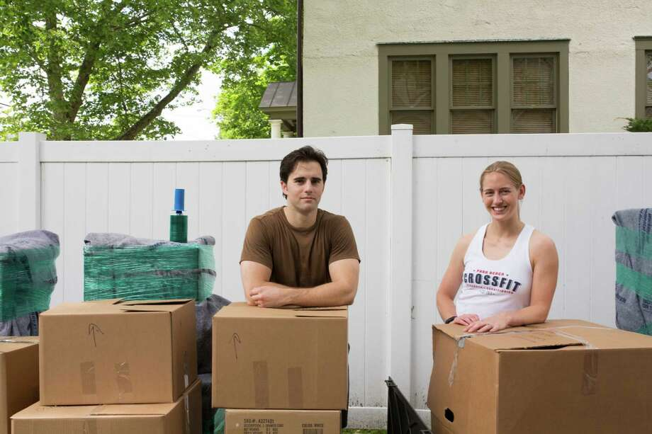 James Higgins, left, and his wife, Trish Higgins, prepare for a move to Maine to buy a business, in Cos Cob, Conn., June 5, 2015. The Higginses are part of a growing trend: people with an entrepreneurial bent who are not inclined to start their own businesses. Rather, they are looking to buy a small to midsize company — often a family-owned one that is being sold by the founder — and helping it prosper. (Christopher Capozziello/The New York Times) Photo: CHRISTOPHER CAPOZZIELLO, STR / New York Times / NYTNS