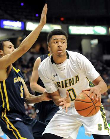 Siena's Javion Ogunyemi, right, controls the ball as Canisius' Kassius Robertson defends during their basketball game on Thursday, Feb. 19, 2015, at Times Union Center in Albany, N.Y. (Cindy Schultz / Times Union) Photo: Cindy Schultz / 00030520B
