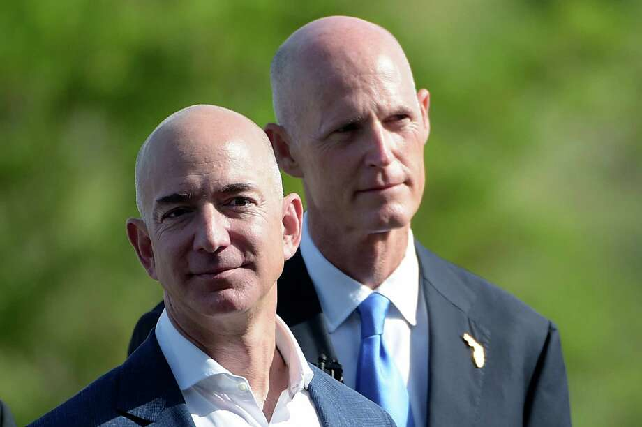 Amazon CEO Jeff Bezos, left, and Florida Gov. Rick Scott arrive for a news conference on the Blue Origin rocket company at Cape Canaveral. Photo: Phelan M. Ebenhack, FRE / FR121174 AP