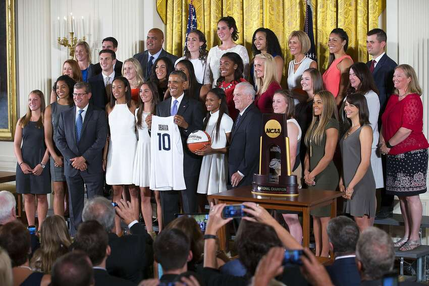 Click through for scenes from the UConn women's basketball team's past visits to the White House.  President Barack Obama on stage with the University of Connecticut Huskies, the 2015 NCAA women's basketball champions, during a ceremony in the East Room of the White House in Washington, Sept. 15, 2015. At left is head coach Geno Auriemma. (Doug Mills/The New York Times)