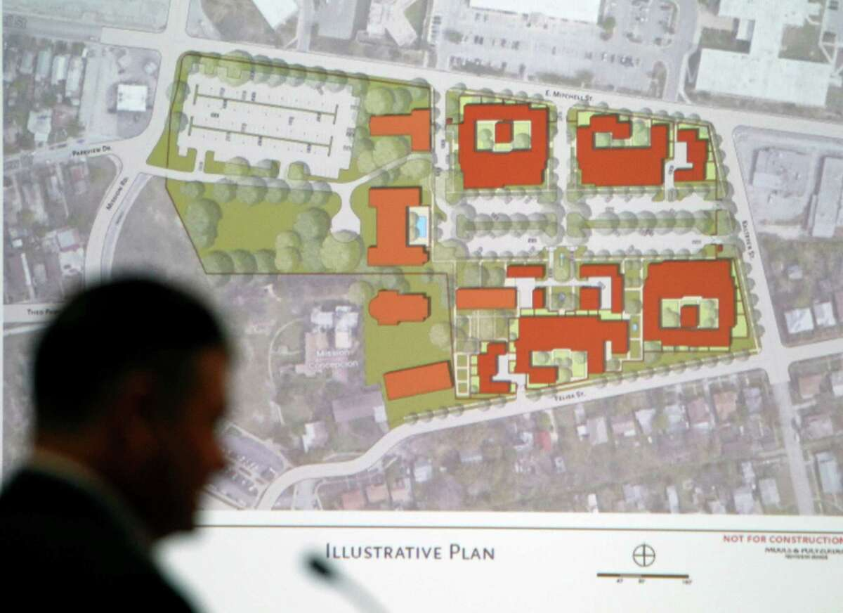 210 Developers Partner David Tolley is silhouetted Tuesday by a proposed plan to redevelop the former seminary near Mission San José. . The zoning change requested by the developers was approved on a 6-0 vote of commissioners.