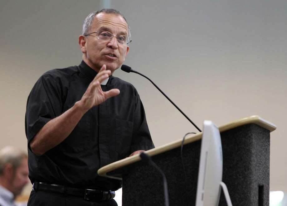 Father David Garcia: Pilgrims passing through the Holy Door will experience a changing of attitudes. Photo: William Luther /San Antonio Express-News / © 2015 San Antonio Express-News