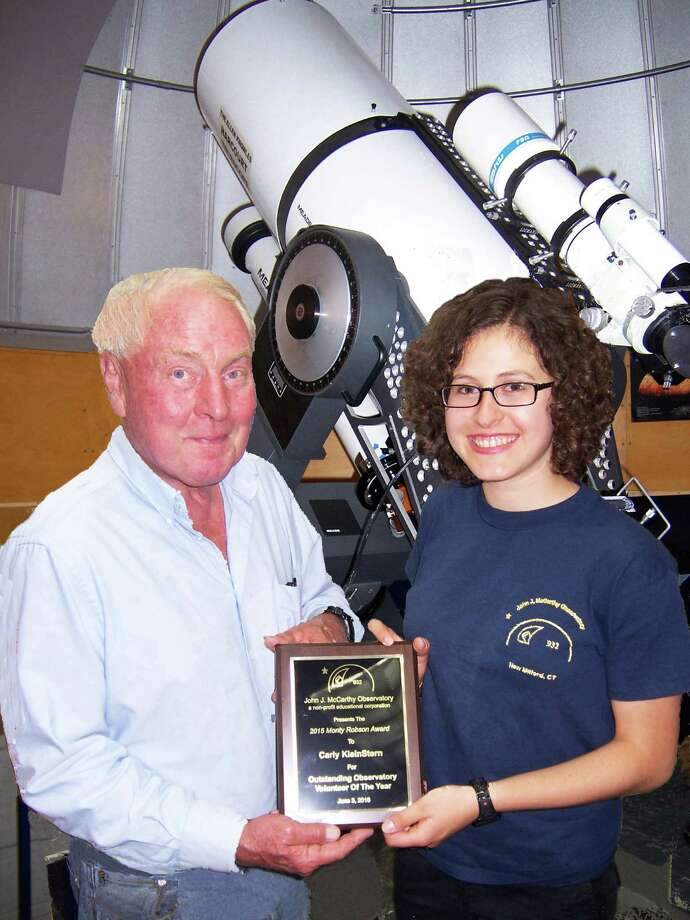 Carly KleinStern of New Milford, was recently honored with the 2015 Monty Robson Award for Outstanding Volunteer of the Year by the John J. McCarthy Observatory board of directors in New Milford. Above, Carly is presented a special plaque by Monty Robson, board president and observatory director, June 3. Carly, a recent graduate and 2015 class salutatorian of New Milford High School, has been volunteering and doing public outreach presentations at the observatory, in addition to doing imaging and research on nebulae, asteroids and comets for the past three years. She is a freshman at Brandeis University in Massachusetts. Photo: Courtesy Of Arthur Klein / The News-Times Contributed