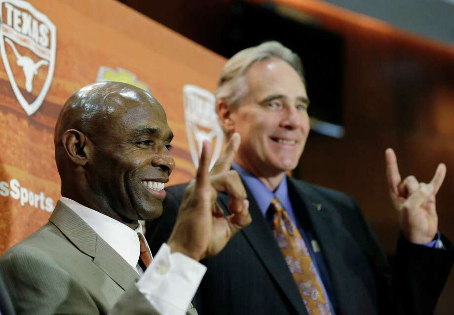 Steve Patterson's highest-profile move during his relatively brief tenure in Austin was the hiring of football coach Charlie Strong to succeed Mack Brown. Patterson also hired basketball coach Shaka Smart. Photo: Eric Gay, STF / AP