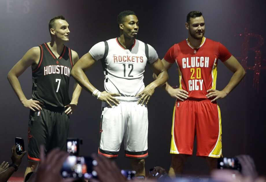 Houston Rockets  Sam Dekker, left,  Dwight Howard, and Donatas Motiejunas, right, model the team's alternate uniforms during an event at the House of Blues Tuesday, Sept. 15, 2015, in Houston. ( Melissa Phillip  /  Houston Chronicle ) Photo: Houston Chronicle