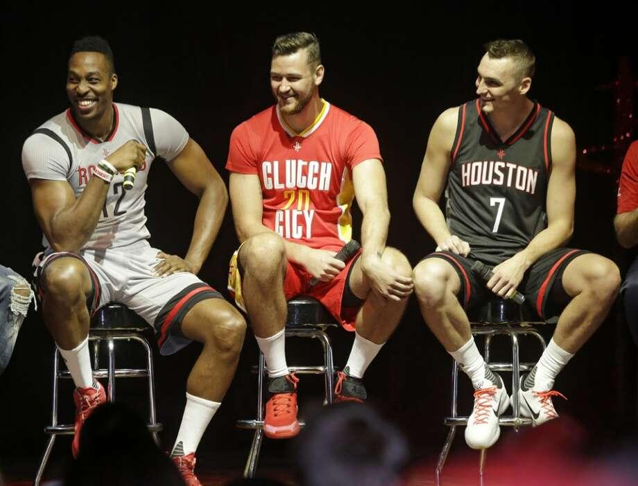 099710fd361 Houston Rockets Dwight Howard,left, Donatas Motiejunas, and Sam Dekker  right, talk