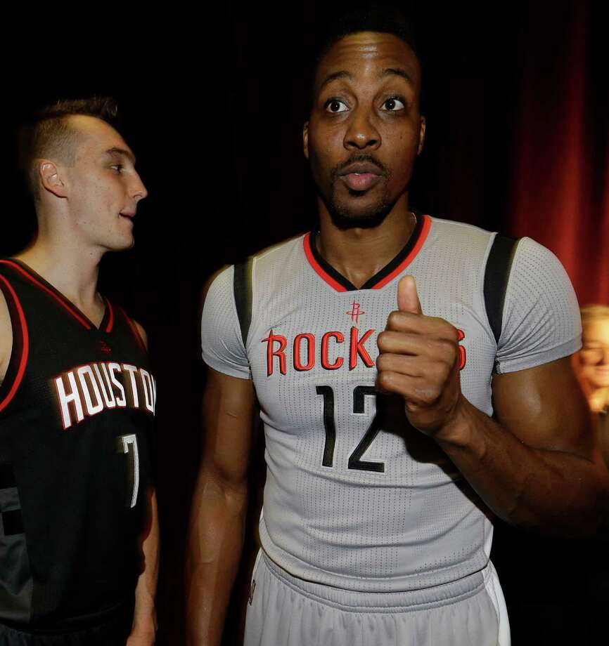 Houston Rockets  Sam Dekker, left,  and Dwight Howard, right, are shown back stage after modeling the team's alternate uniforms during an event at the House of Blues Tuesday, Sept. 15, 2015, in Houston. ( Melissa Phillip  /  Houston Chronicle ) Photo: Melissa Phillip, Staff / © 2015 Houston Chronicle
