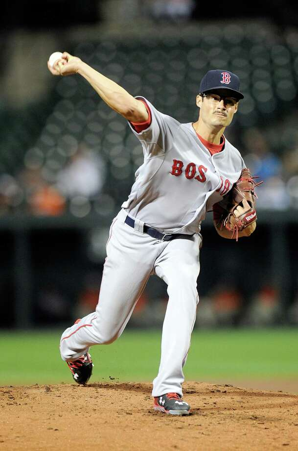 BALTIMORE, MD - SEPTEMBER 15:  Joe Kelly #56 of the Boston Red Sox pitches in the second inning against the Baltimore Orioles at Oriole Park at Camden Yards on September 15, 2015 in Baltimore, Maryland.  (Photo by Greg Fiume/Getty Images) ORG XMIT: 538594913 Photo: Greg Fiume / 2015 Getty Images