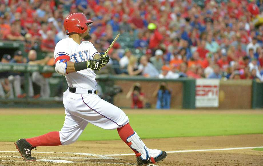 The Texas Rangers' Rougned Odor gets a broken-bat single and an RBI during the first inning against the Houston Astros at Globe Life Park in Arlington, Texas, on Tuesday, Sept. 15, 2015. (Max Faulkner/Fort Worth Star-Telegram/TNS) Photo: Max Faulkner, MBR / Fort Worth Star-Telegram