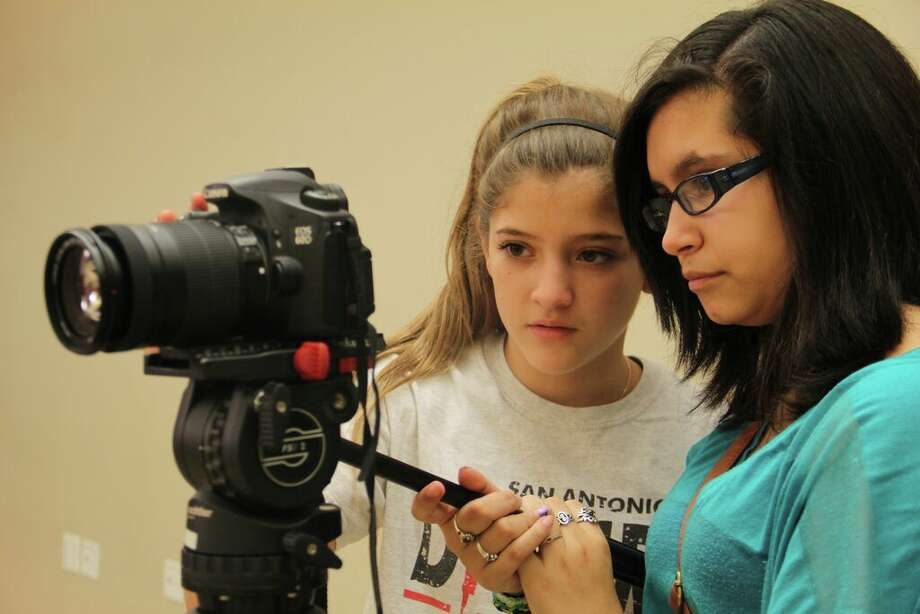 Two WAM (Working Artists and Mentors) middle school students work collaboratively to create a stop-motion animation film. Peer-to-peer learning is an integral part of SAY Si's mission. Photo: Courtesy SAY Si