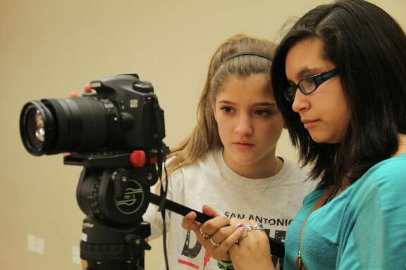 Two WAM (Working Artists and Mentors) middle school students work collaboratively to create a stop-motion animation film. Peer-to-peer learning is an integral part of SAY Si's mission.