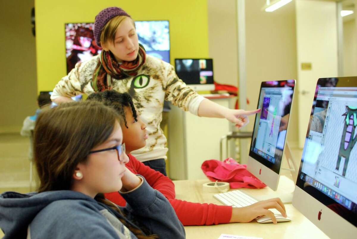 In SAY Si's WAM (Working Artists and Mentors) Middle School Program, high school media arts student Annie Clark works as a mentor for her middle school peers.