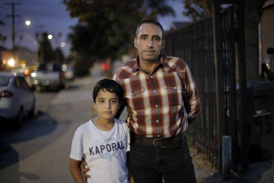 Mohammad Rawas escaped from Syria with his wife and four children, and after some time moving around the middle east, have settled into a home in Oakland, Calif. He is seen here with his sone Mohamad, 10, in their neighborhood on Tuesday, September 15, 2015. Photo: Carlos Avila Gonzalez, The Chronicle