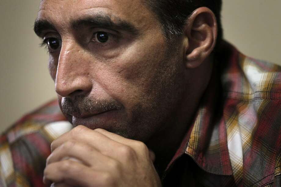 Mohammad Rawas escaped from Syria with his wife and four children, and after some time moving around the middle east, have settled into a home in Oakland, Calif. He is seen here sharing his story on Tuesday, September 15, 2015. Photo: Carlos Avila Gonzalez, The Chronicle