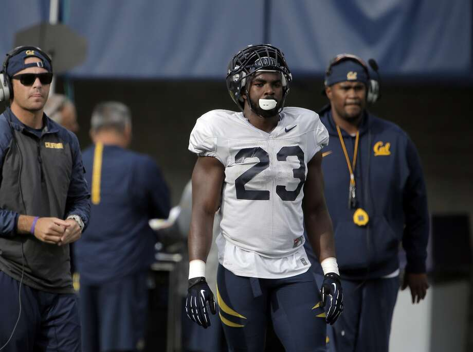 Cal running back Vic Enwere (23) watches a play from the sidelines during Cal football practice in Berkeley, Calif., earlier this week. Photo: Carlos Avila Gonzalez, The Chronicle