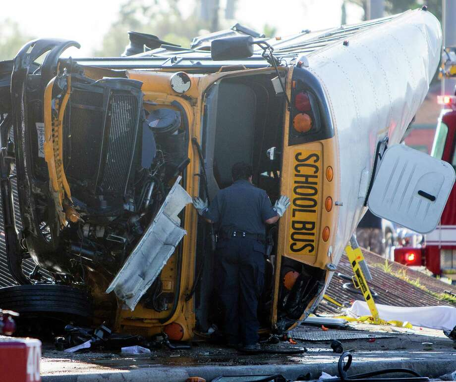 "Authorities work the scene of a bus wreck that killed two high school students on the eastbound frontage road of Loop 610 near Telephone Road in Houston. ""The State of Texas mourns the loss of Texas students today in a tragedy no parent should ever have to experience,"" Gov. Greg Abbott said in a statement. Photo: Cody Duty /Houston Chronicle / © 2015 Houston Chronicle"