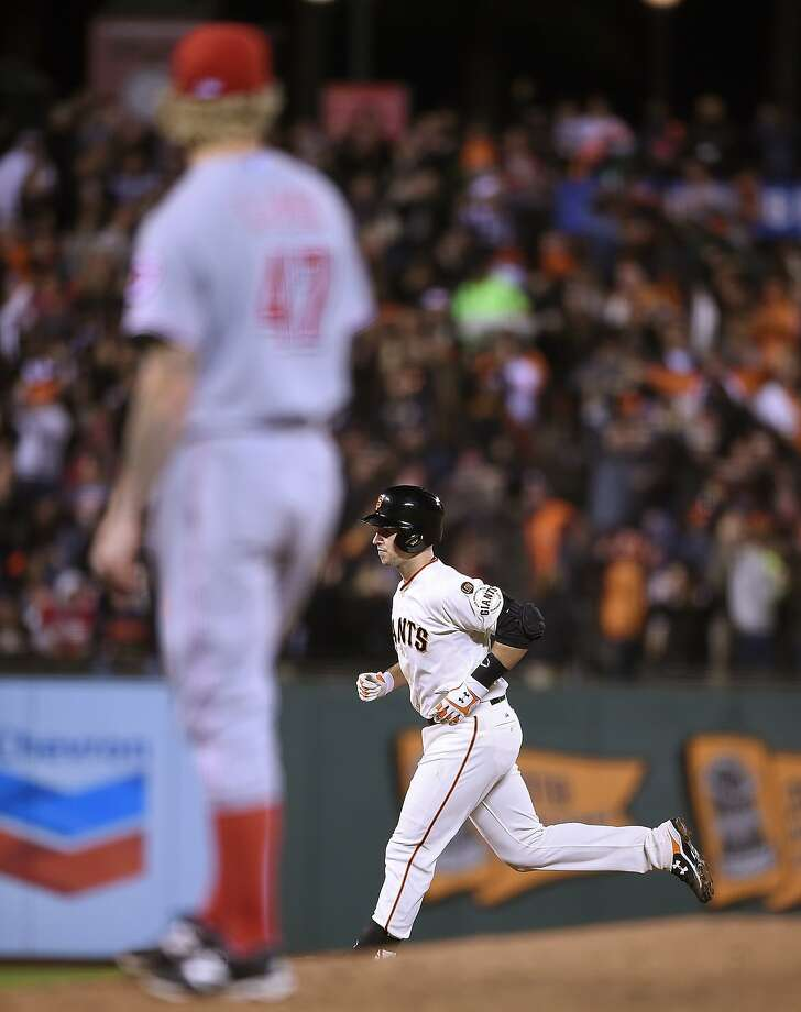 Buster Posey of the San Francisco Giants trots around the bases after hitting a three-run homer off of John Lamb #47 of the Cincinnati Reds in the bottom of the fourth inning at AT&T Park on September 15, 2015 in San Francisco, California. Photo: Thearon W. Henderson, Getty Images