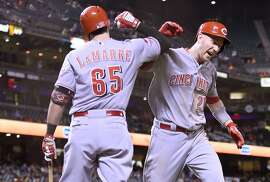 SAN FRANCISCO, CA - SEPTEMBER 15:  Todd Frazier #21 and Ryan LaMarre #65 of the Cincinnati Reds celebrates after Frazier hit a solo home run against the San Francisco Giants in the top of the tenth inning at AT&T Park on September 15, 2015 in San Francisco, California.   (Photo by Thearon W. Henderson/Getty Images)