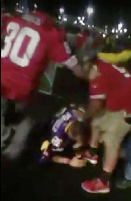 A fight after the 49ers Vikings game on Monday night was caught on video, showing a man in a Vikings jersey getting repeatedly kicked and punched in a parking lot of Levi's Stadium. Photo: YouTube