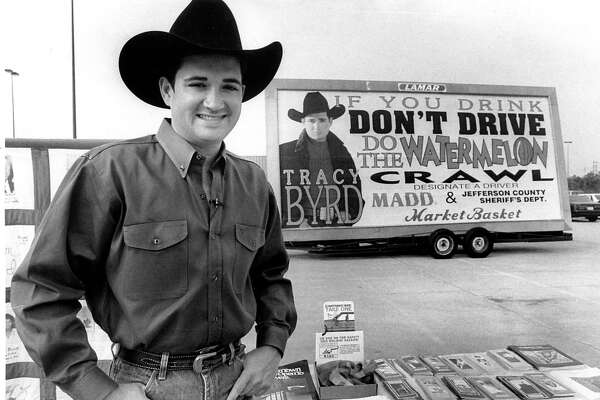 Tracy Byrd next to an anti drinking and driving advertisement in 1994. Enterprise file photo