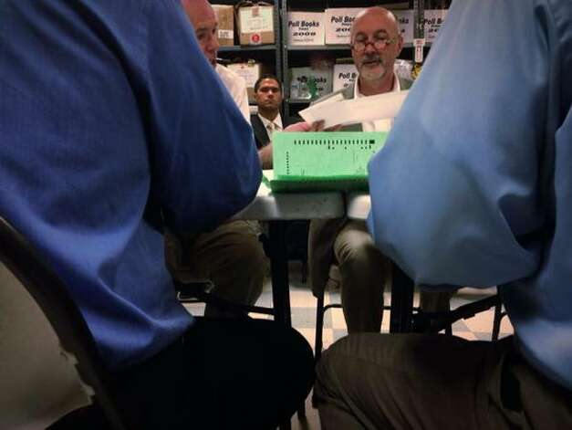 The Rensselaer County Board of Elections counts absentee ballots on Wednesday, Sept. 16, 2015, to decide who will represent the Democratic party in the race for Troy mayor. (Paul Buckowski/Times Union)