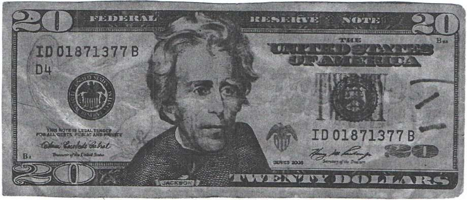 The Kountze Police Department is warning people to be aware of fake $20 bills circulating through local businesses. Authorities say the bills were made from the 2003 design and have poor coloration on the back. Photo: Courtesy Of Kountze PD