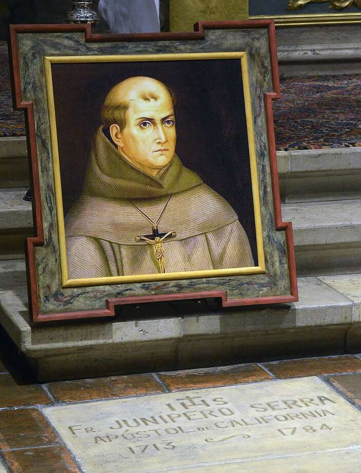 A painting of the Rev. Junipero Serra is seen above his grave inside the basilica at the Carmel Mission. Photo: David Royal, Associated Press