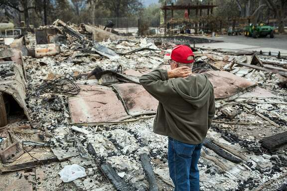 "Jay Albertson takes a moment as he views his burned down home of 30 years after it was destroyed by the Valley Fire in Hidden Valley Lake, Calif., on Tuesday, Sept. 15, 2015. ""This is a chapter in our lives that is gone forever,"" he said. (Marcus Yam/Los Angeles Times/TNS)"