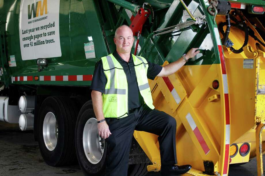 John Morris, Senior VP of Field Operations for Waste Management posed for a portrait Wednesday, Sept. 2, 2015, in Houston. Morris started his career on the back of a garbage truck and is now and executive.  ( Steve Gonzales / Houston Chronicle ) Photo: Steve Gonzales, Staff / © 2015 Houston Chronicle