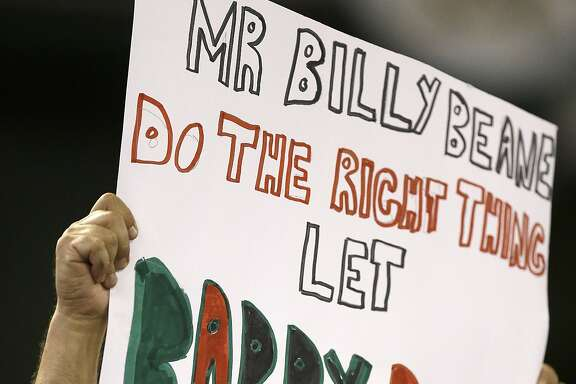 Oakland Athletics fan holds up a sign in reference to pitcher Barry Zito during a baseball game against the Houston Astros Wednesday, Sept. 9, 2015, in Oakland, Calif. (AP Photo/Ben Margot)