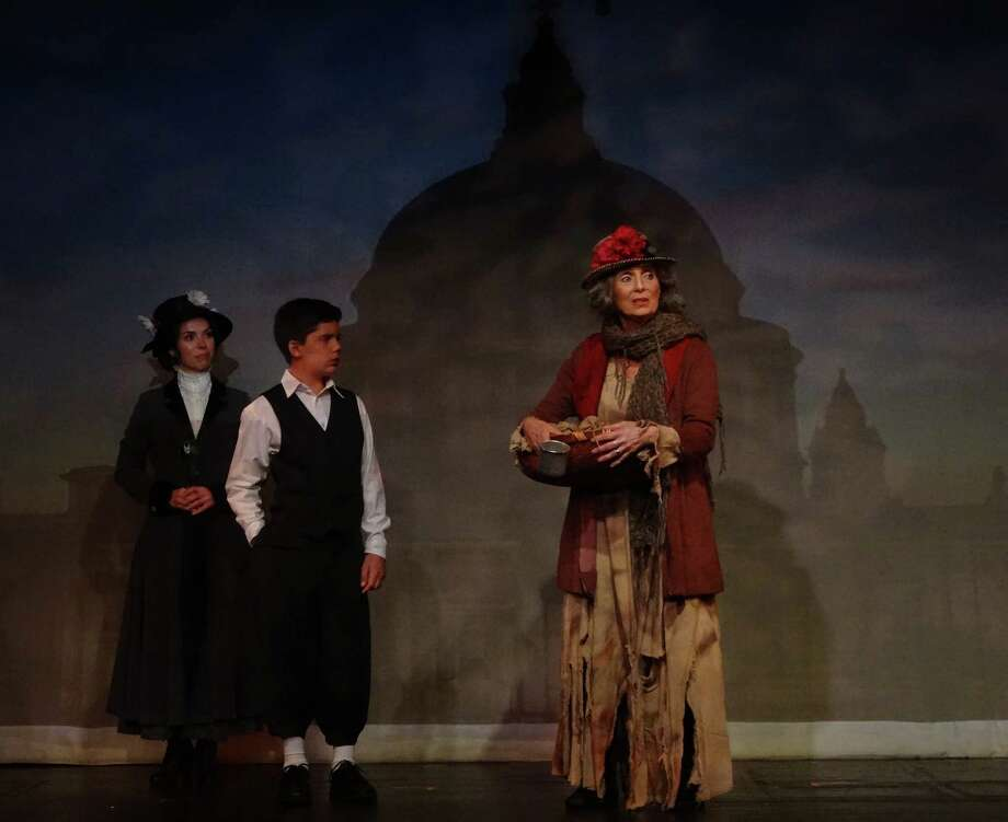 "Mary Poppins, played by Sarah Giggar, takes her young charge, Michael Banks, played by Javier Gonzalez, to the park where the two meet the Birdwoman, played by Gail Yudain, in a scene from Curtain Call's production of ""Mary Poppins."" The show will run through Saturday, Oct. 17 at the Kweskin Theatre in Stamford. Photo: Contributed Photo / Stamford Advocate Contributed"