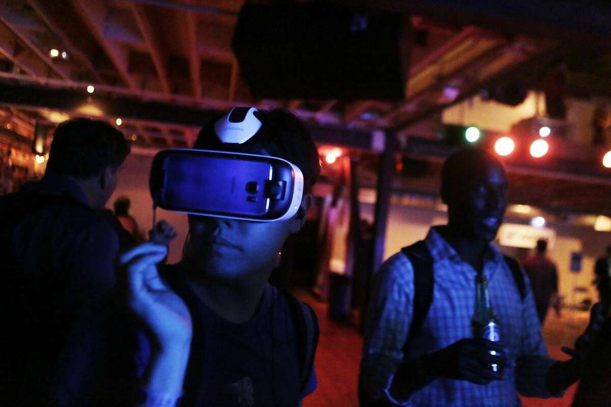 Albert Park of San Jose experiences virtual reality during the Kaleidoscope VR Film Festival at the Public Works building in San Francisco, Ca. on Tuesday, September 15, 2015.