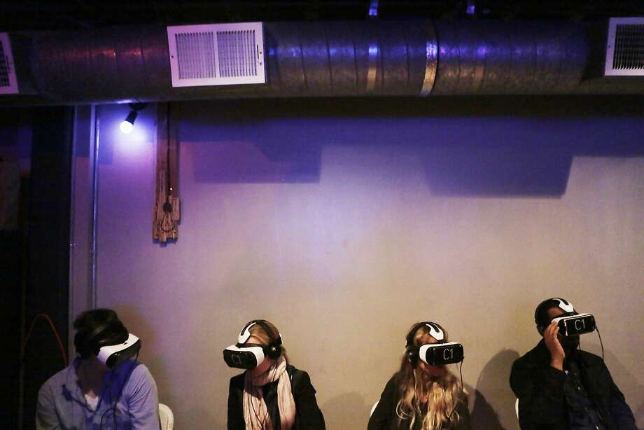 Attendees put on virtual reality headsets to see movies at the Kaleidoscope VR Film Festival in San Francisco. Photo: Dorothy Edwards, The Chronicle