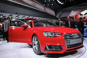 FRANKFURT AM MAIN, GERMANY - SEPTEMBER 15:  The new Audi A 4 stands at the Audi stand at the 2015 IAA Frankfurt Auto Show during a press day on September 15, 2015 in Frankfurt, Germany. The IAA, Germany's biggest auto show, which takes place every two years, will be open to the public from September 17 through 27.