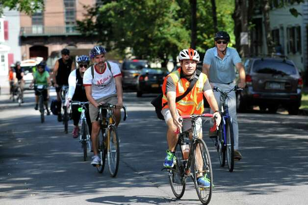 Greg Francese, project coordinator of Parks and Trails New York, center, leads fellow cyclists along Church Street during a Bike-a-Round to experience the city from the perspective of a cycling tourist on Wednesday, Sept. 16, 2015, in Schenectady, N.Y. (Cindy Schultz / Times Union) Photo: Cindy Schultz / 00033353A