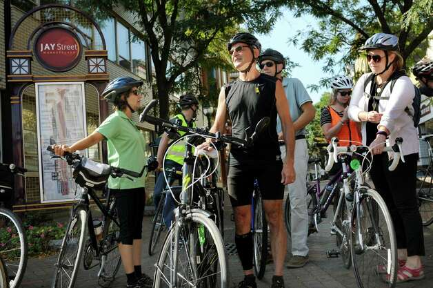 From left, Robin Dropkin of Parks and Trails New York, Bert Schou of the Albany Bicycle Coalition, and Jennifer Ceponis of the Capital District Transportation Committee, join others for a Bike-a-Round to experience Schenectady from the perspective of a cycling tourist on Wednesday, Sept. 16, 2015, at Jay Street in Schenectady, N.Y. (Cindy Schultz / Times Union) Photo: Cindy Schultz / 00033353A