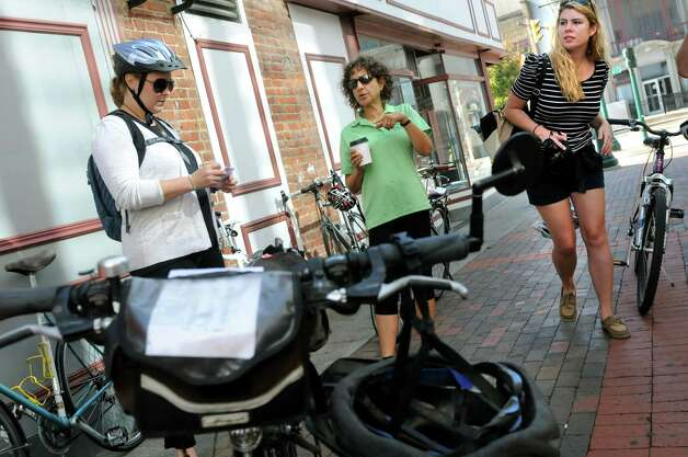 Jennifer Ceponis of the Capital District Transportation Committee, left, joins Robin Dropkin, center, and Elizabeth Levesque, both of Parks and Trails New York prepare for a Bike-a-Round to experience the city from the perspective of a cycling tourist on Wednesday, Sept. 16, 2015, in Schenectady, N.Y. (Cindy Schultz / Times Union) Photo: Cindy Schultz / 00033353A