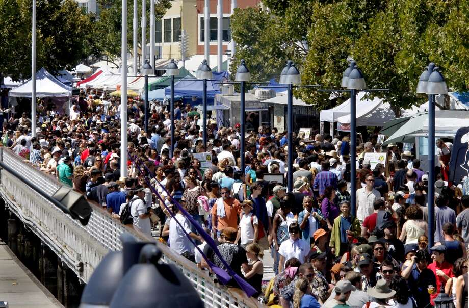 Thousands jammed the waterfront for the festival and a produce market on a cool sunny day. The first annual Eat Real festival finished up Sunday at Oakland's Jack London Square. About 30,000 a day showed up from Friday to Sunday to sample locally produced foods from the Bay Area. Photo: Brant Ward, The Chronicle 2009