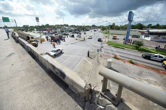 A portion is seen missing from the guardrail at the scene of a fatal bus wreck on the eastbound frontage road of the South Loop near Telephone Road, Tuesday, Sept. 15, 2015, in Houston. Witnesses say two girls and two boys were on the bus, along with the driver. One  girl died while the injured students and bus driver were rushed to area hospitals, said Holly Huffman, a spokeswoman for the Houston Independent School District. The district confirmed a second female student died after being taken to a hospital.