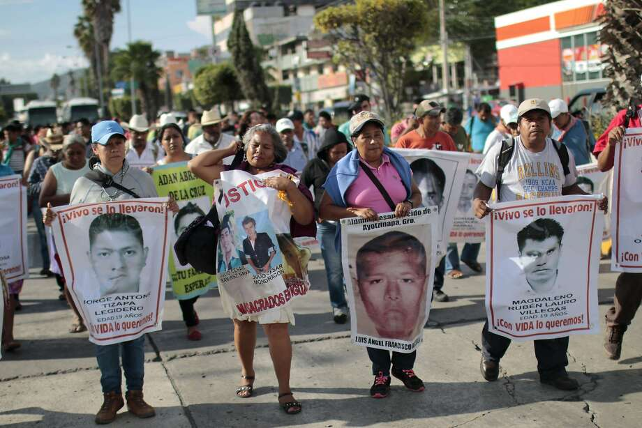 Relatives of the 43 missing students protest with their portraits in Chilpancingo, Guerrero state. Photo: Pedro Pardo, AFP / Getty Images