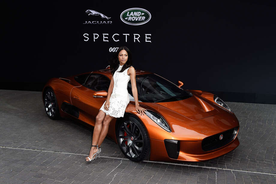 Jaguar and Land Rover displayed vehicles from the upcoming James Bond film 'Spectre' in Frankfurt on Tuesday evening. Naomie Harris, who plays Moneypenny in the film, shows off the Jaguar C-X75, which will be a villain-mobile in 'Spectre.' Bond will drive an Aston Martin DB10. Photo: Ian Gavan, Getty Images / 2015 Getty Images