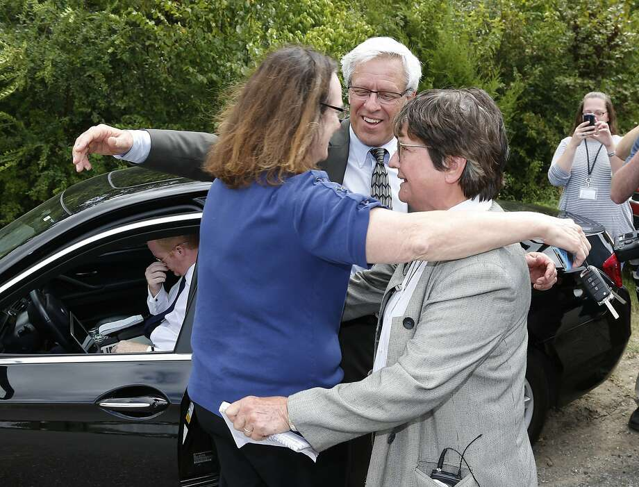Two of Richard Glossips's attorneys embrace Sister Helen Prejean after the scheduled execution for Glossip was stayed. Photo: Sue Ogrocki, Associated Press