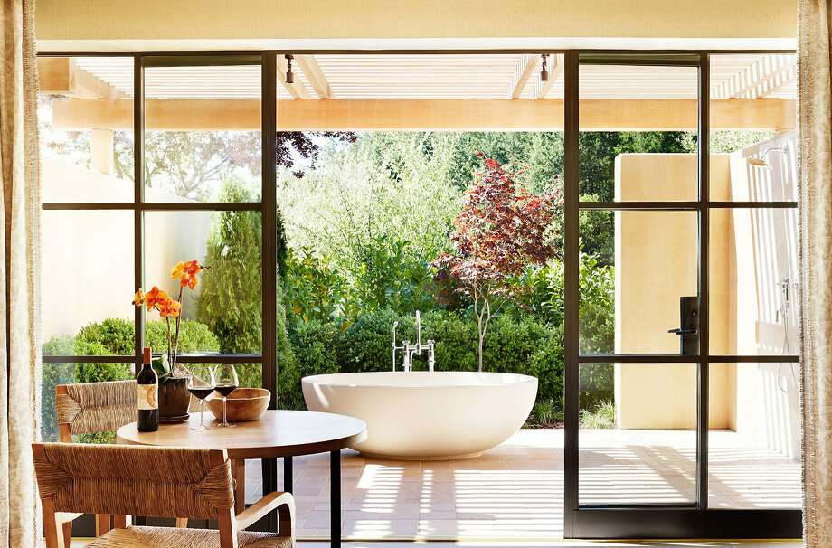 In Auberge du Soleil's Maison Saint-Tropez, glass doors open to a private terrace where a simple, oversize bathtub and rain shower beckon guests outside. Photo: Trinette Reed Photography