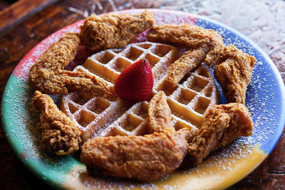The Wings & Waffle plate is served at the Signature Kafe, a second restaurant location opened by the owner of the Breakfast Klub.