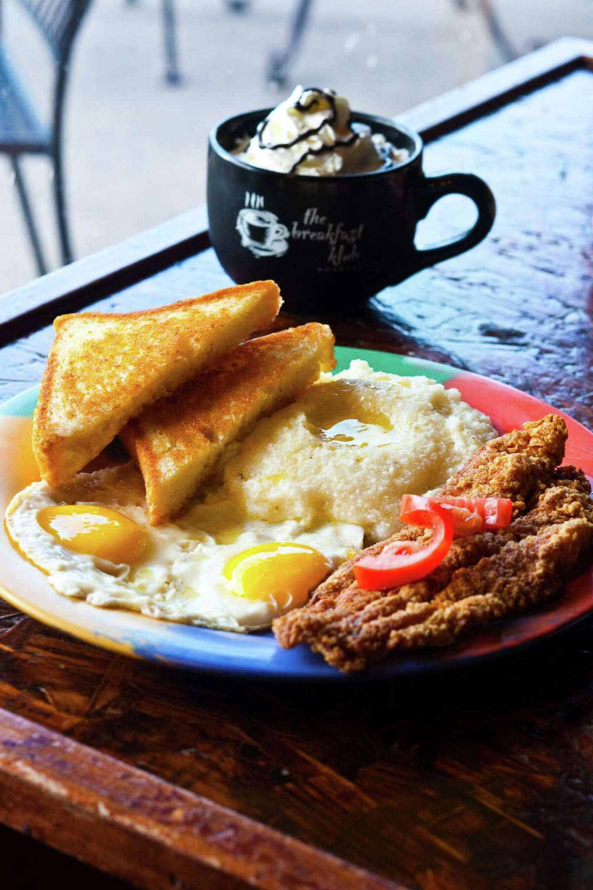 Katfish & Grits plate. Marcus Davis who along with his wife Mel, opened Breakfast Klub in Houston 10 years ago. They will be marking their 10th anniversary on Oct. 1. Photographed Sept. 20, 2011 in Houston. (Eric Kayne/For the Chronicle)