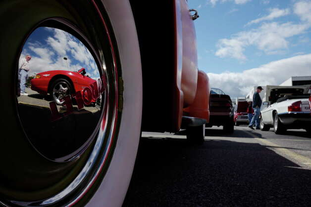 The hub cap on a 1953 Chevrolet pickup truck, reflects a Ford Cobra that was the 1994 official pace car of the Indianapolis 500 at the 3rd Annual Time Union Car Show at the Times Union on Sunday, Sept. 22, 2013 in Colonie, NY.  The event raises money for the Times Union Hope Fund.   (Paul Buckowski / Times Union) Photo: Paul Buckowski / 00023756A
