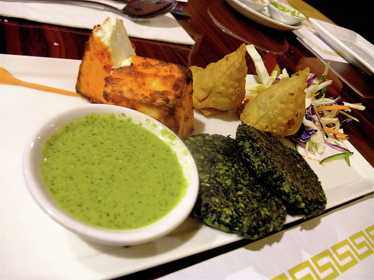 Appetizer platter with paneer/spinach patties, paneer tikka and green chutney at Great W'Kana Cafe.