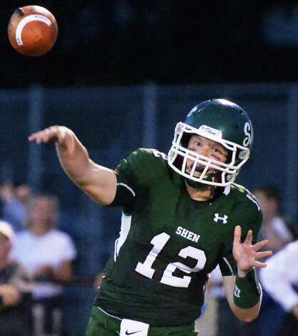 Shen quarterback Eric Morris completes a pass to Carl Fiore for a touch down during Saturday night's game against Shaker at Shenendehowa High Sept. 11, 2015 in Clifton Park, NY.  (John Carl D'Annibale / Times Union) Photo: John Carl D'Annibale / 00033300A