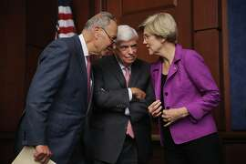 WASHINGTON, DC - JULY 21:  Sen. Chuck Schumer (D-NY) (L) and Sen. Elizabeth Warren (D-MA) talk with former Sen. Chris Dodd (D-CT) during a news conference to discuss the fifth anniversary of the Dodd-Frank Wall Street Reform and Consumer Protection Act at the U.S. Capitol Visitors Center July 21, 2015 in Washington, DC. Dodd said the legislation has made great strides in reforming American financial institutions but more work lies ahead.  (Photo by Chip Somodevilla/Getty Images) *** BESTPIX ***